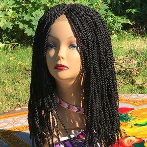Brazilian twist wig on a closure. Color is black